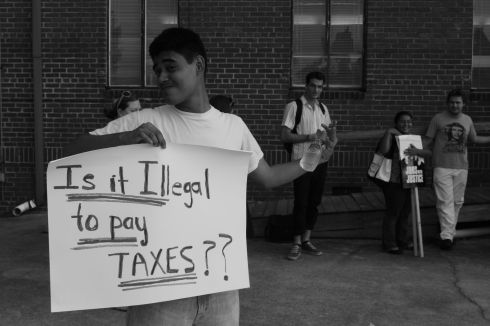 Is it illegal to pay taxes?